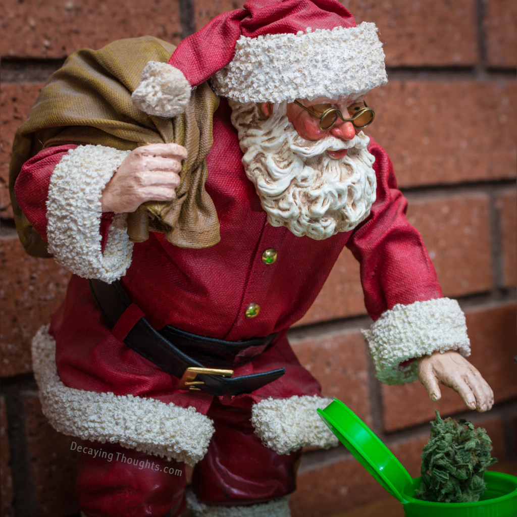 Santa reaching for a bud of Cannabis in a poptop container